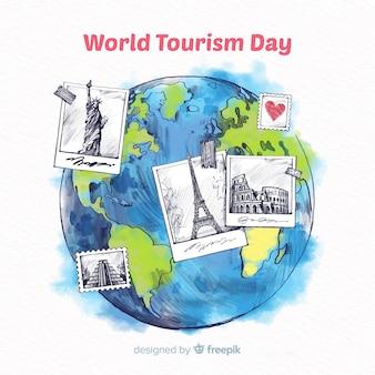 Welttourismustageshintergrund mit gezeichneten art der monumente in der hand