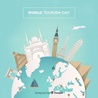 Welttourismustageshintergrund mit monumenten um erde