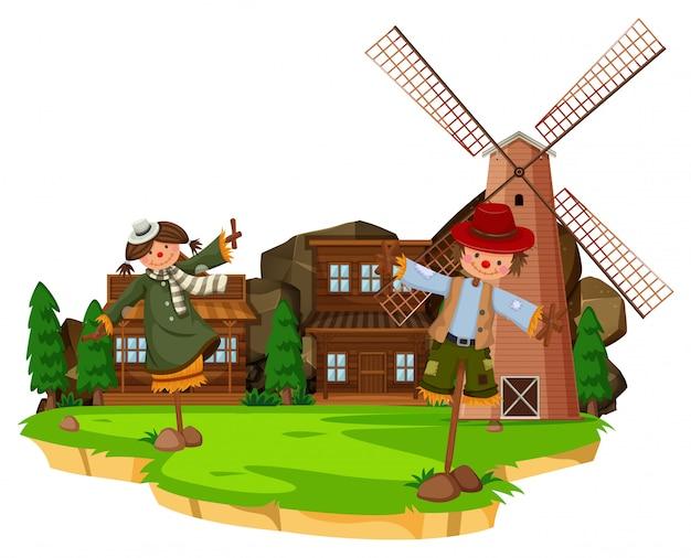 Westliche bauernhofszene mit vogelscheuchen und windmühle
