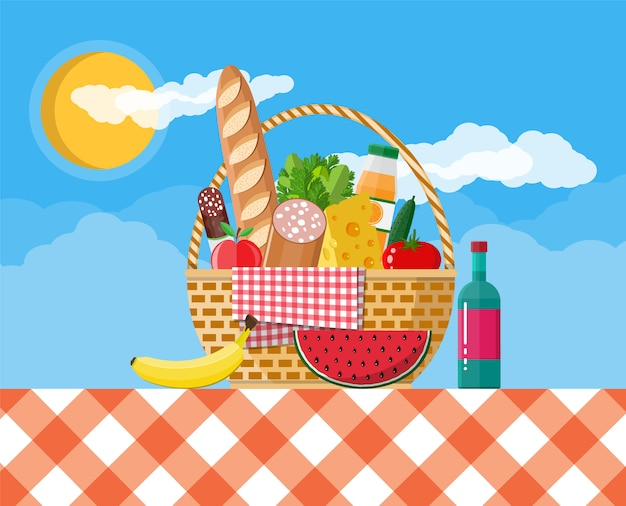 Wicker picknickkorb voller produkte.