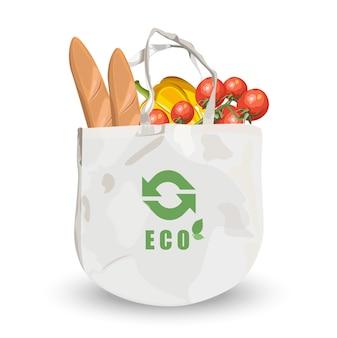 Wiederverwendbare umweltfreundliche stofftasche mit lebensmitteln im inneren. brot, tomaten und kürbis