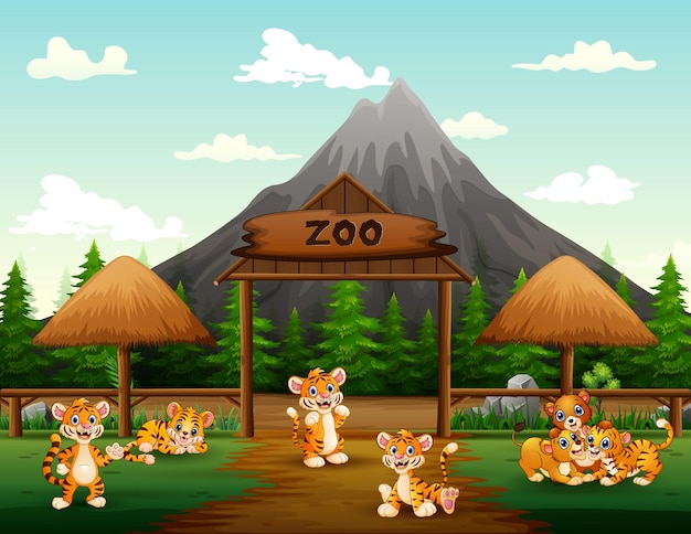Wilde tiere der karikatur, die im geöffneten zoo spielen
