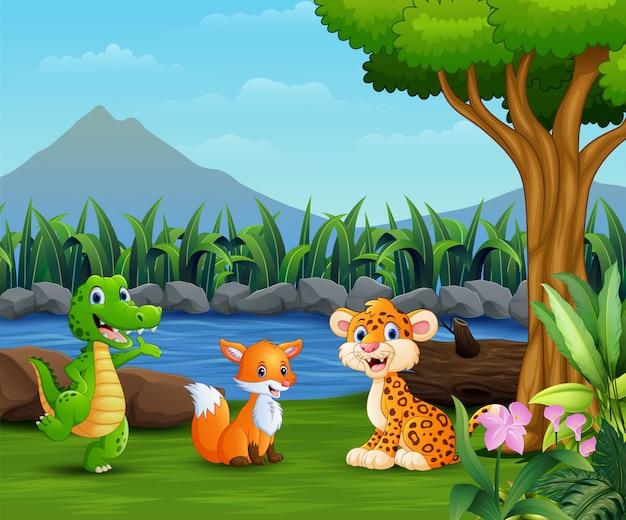 Wilde tiere, die auf der schönen landschaft spielen