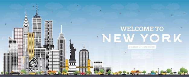 Willkommen in der skyline von new york usa mit grauen gebäuden und blauem himmel
