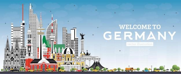 Willkommen in deutschland skyline mit grauen gebäuden und blauem himmel. deutschland-stadtbild mit sehenswürdigkeiten.