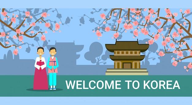 Willkommen in südkorea, koreanisches coupé in traditionellen kostümen über seoul sehenswürdigkeiten