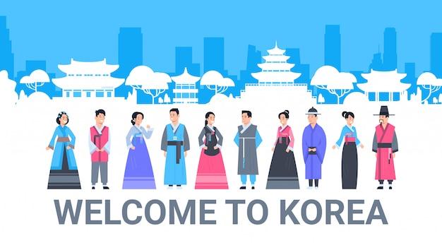 Willkommen zu korea-leuten in den traditionellen kostümen über palast-berühmtem koreanischem markstein-schattenbild-tourismus