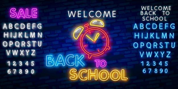 Willkommen zurück in der schule. neonarteffekt des typografieschriftart-alphabetes