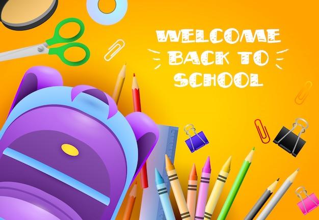 Willkommen zurück in der schule schriftzug mit briefpapier und rucksack