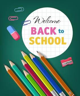 Willkommen zurück in der schule schriftzug mit buntstiften