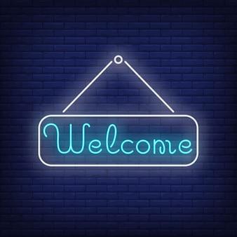 Willkommene neonbeschriftung auf tablette. einladung.