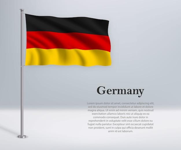 Winkende flagge deutschlands am fahnenmast