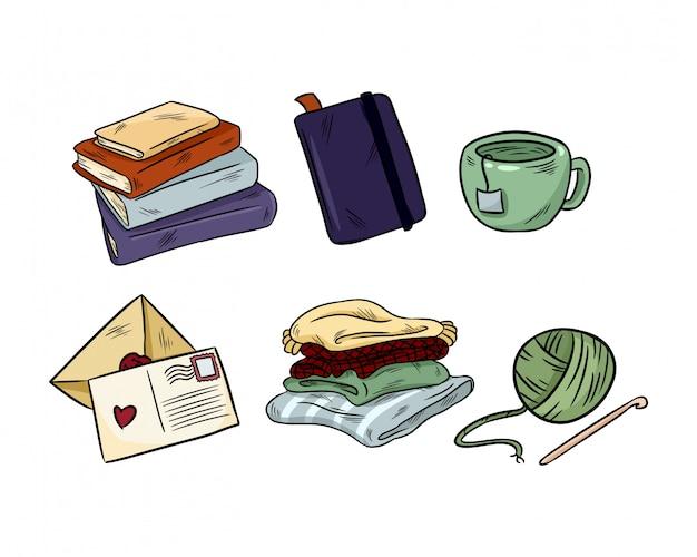 Winter gemütliche hygge favoriten kritzeleien. süße aufkleber. bücher, notizbuch, becher, plaids, stricken
