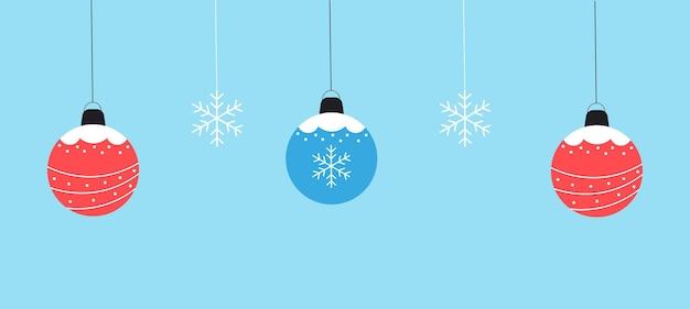 Winter hintergrund von kugeln und schneeflocken vektorgrafiken im flachen stil