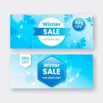 Winter sale banner mit verschwommenen elementen gesetzt