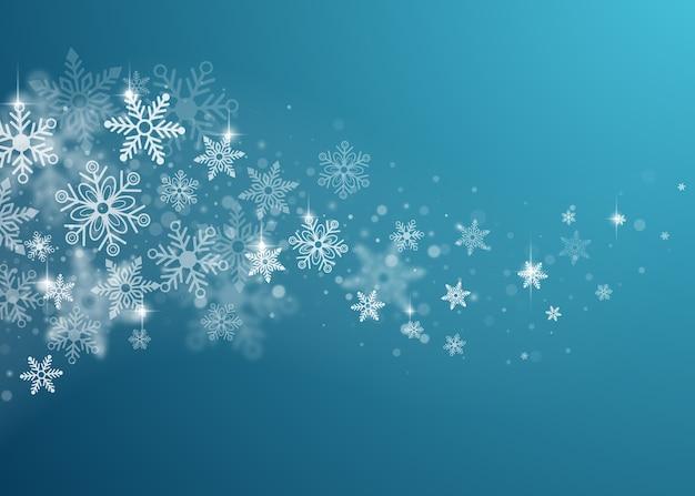 Winter schneebedeckter abstrakter hintergrund. fliegende schneeflocken.