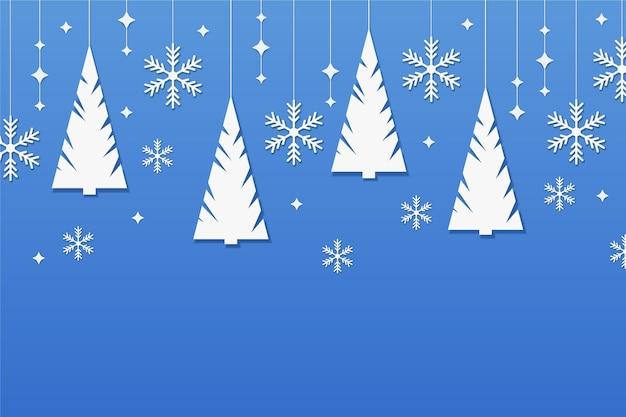 Winterhintergrund im papierstil mit bäumen