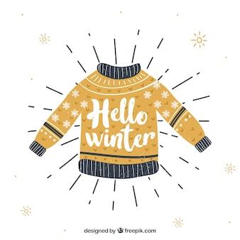 Winterhintergrund mit einem gelben gestrickten pullover