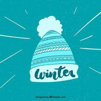 Winterhintergrund mit einer strickmütze