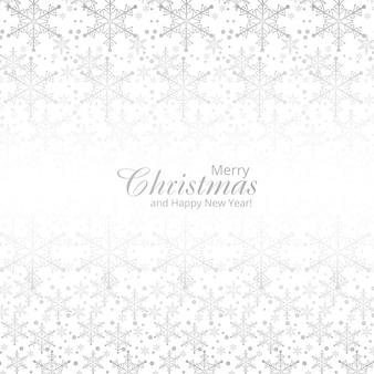 Winterhintergrund mit karte der frohen weihnachten der schneeflocken