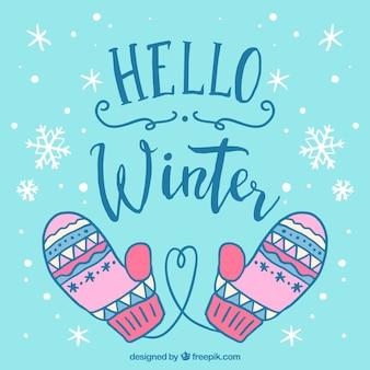 Winterhintergrund mit rosa gestrickten handschuhen