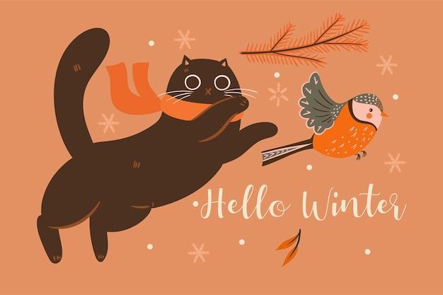 Winterkatze und ein vogel.