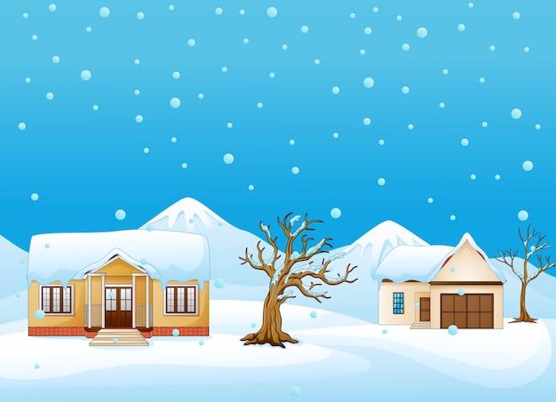 Winterlandschaft mit haus und trockenem baum an den bergen