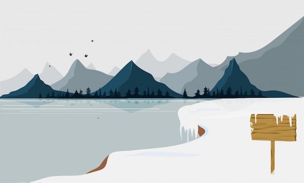 Winterlandschaft mit schnee, see und berg.