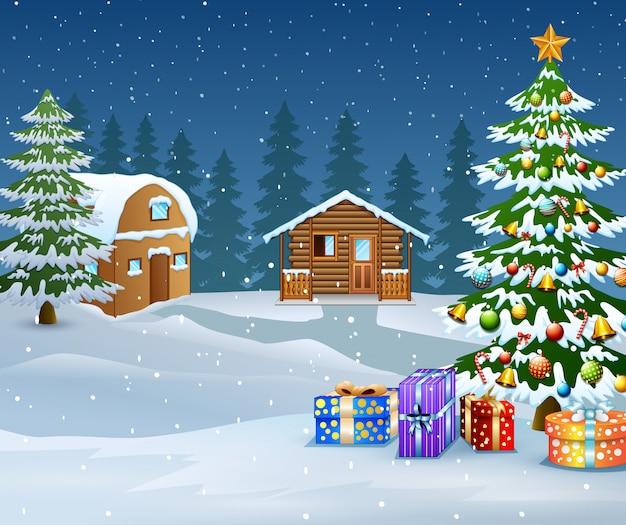 Winterlandschaft mit schneeholzhaus und weihnachtsbaum