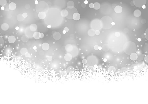 Winterliche weihnachtsillustration mit schneeflocken auf silbergrauem bokeh-hintergrund