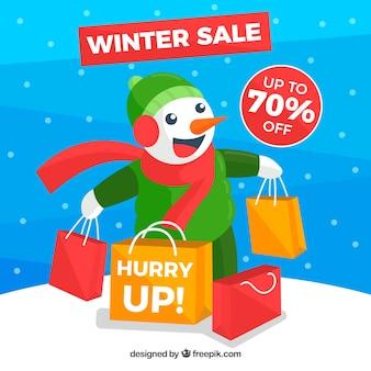 Winterschlussverkaufhintergrund mit glücklichem schneemann