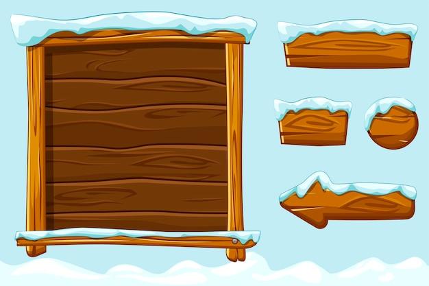 Winterspiel ui holzknöpfe mit schnee. set holz assets, interface und buttons für ui game.