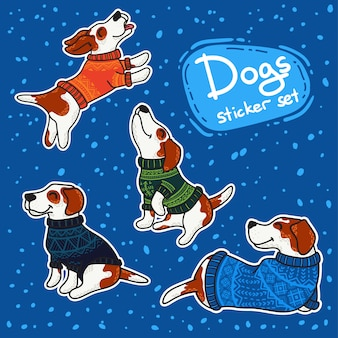 Winterstikers eingestellt mit hunden in den bunten strickjacken