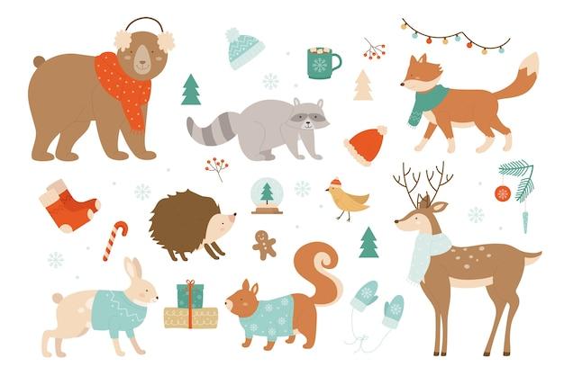 Wintertiere weihnachtsset mit dekorativen weihnachtselementen, niedliche tiere, die winterkleidung tragen