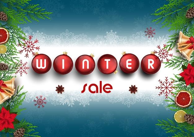 Winterverkaufshintergrund mit tannenzweigen und bällen