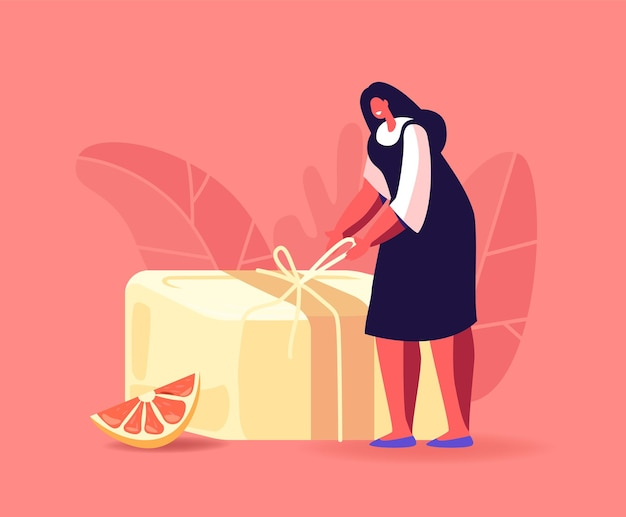 Winzige weibliche charakter-packstange aus handgemachter seife bereiten sich auf den verkauf oder die geschenkpräsentation vor.