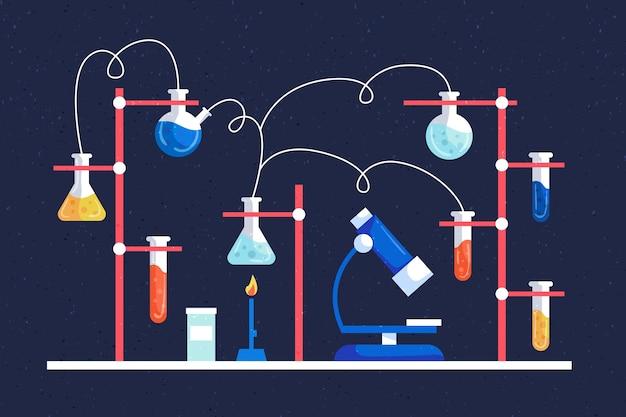 Wissenschaftslaborelemente packen auf tisch