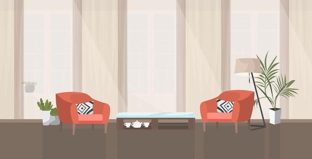 Wohnbereich oder wartezimmer mit roten sesseln und modernem büro-interieur des couchtischs