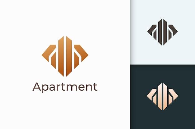 Wohnungs- oder immobilienlogo in rautenform für immobilienunternehmen