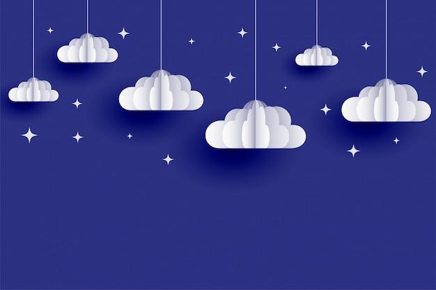 Wolken und sterne hintergrund im papierschnittstil