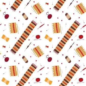 Wollschals nahtloses muster stricken. winterstrickwaren mit handgezeichneter illustration der volksverzierungen. handwerkliche werkzeuge, häkeln, stifte, garnkugeln, garnrollen. tapetendesign