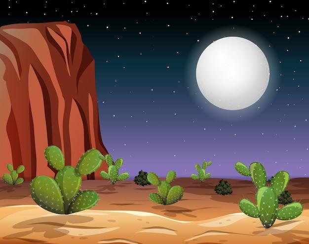 Wüste mit felsenbergen und kaktuslandschaft bei nachtszene