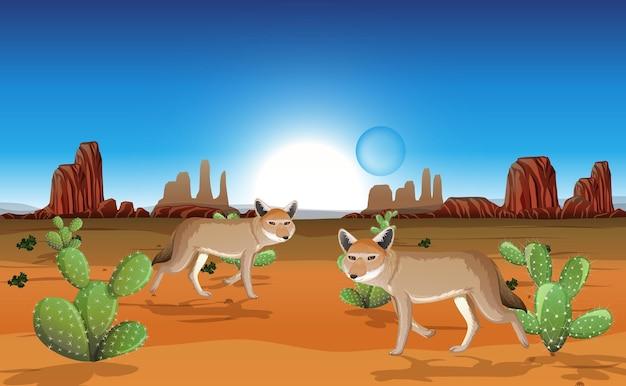 Wüste mit felsenbergen und kojotenlandschaft am tag szene