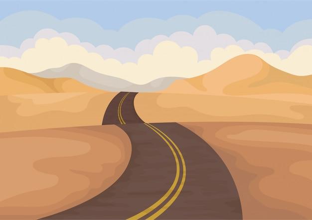 Wüstenlandschaft mit asphaltstraße. tal mit sandhügeln und blauem himmel.