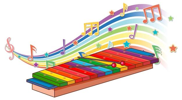 Xylophon mit melodiesymbolen auf regenbogenwelle