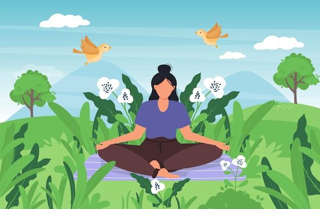 Yoga meditierende frau in der grünen wiese.