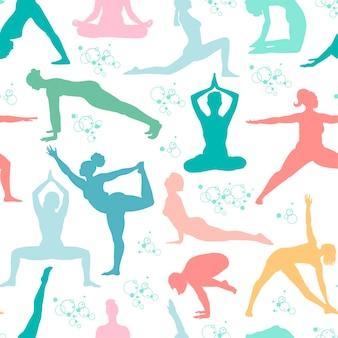 Yoga stellt nahtlose muster silhouetten von frauen in pastellfarben