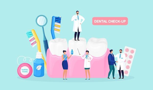 Zahnarzt überprüft, kümmert sich gut und reinigt den zahn. winzige ärzte untersuchen zähne, nehmen zahn- und mundpflege. karies, kariesbehandlung