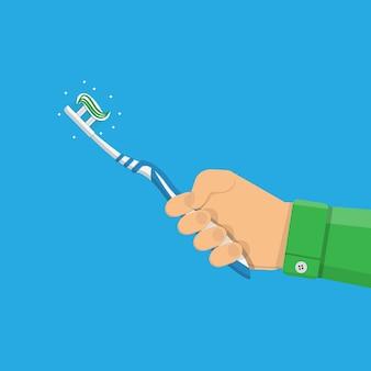 Zahnbürste mit paste in der hand