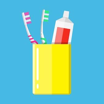 Zahnbürste, zahnpasta in einem glas